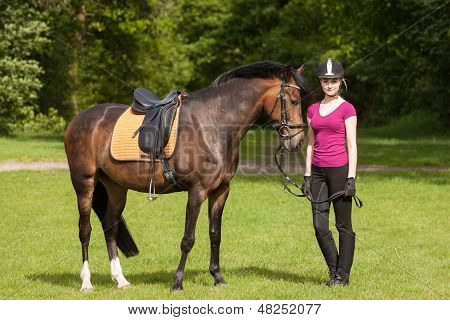 Girl Stands Besides Her Horse