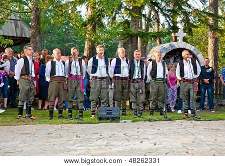 SIROGOJNO, SERBI - JULY 12: Male Choir on festival Petrovdan's days on July 12, 2013. in Sirogojno, Zlatibor, Serbia.