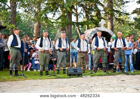 SIROGOJNO, SERBI - JULY 12: Male Choir on festival Petrovdan's days on July 12, 2013. in Sirogojno, Zlatibor, Serbia.
