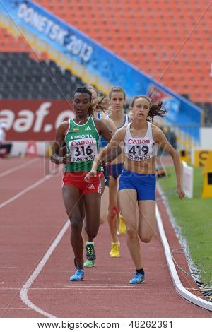 DONETSK, UKRAINE - JULY 11: A. Hinriksdottir, Iceland (right), D. Edao, Ethiopia (left), and other girls compete in 800 m during 8th IAAF World Youth Championships in Donetsk, Ukraine on July 11, 2013