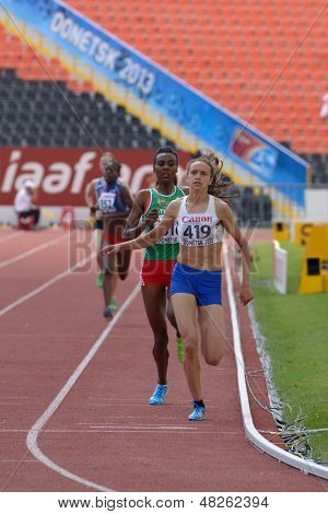 DONETSK, UKRAINE - JULY 11: Anita Hinriksdottir, Iceland (right), Dureti Edao, Ethiopia, and other girls compete in 800 m during 8th IAAF World Youth Championships in Donetsk, Ukraine on July 11, 2013