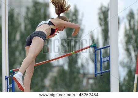 DONETSK, UKRAINE - JULY 11: Ria Mollers of Germany competes in pole vault during 8th IAAF World Youth Championships in Donetsk, Ukraine on July 11, 2013