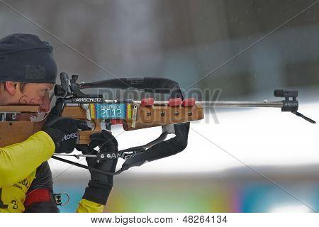 SEEFELD, AUSTRIA - JANUARY 19 Maximilian Janke of team Germany wins the mixed biathlon relay event on January 19, 2012 in Seefeld, Austria.