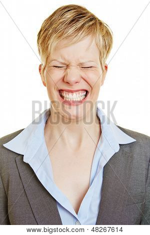 Young business woman making a grimace with her eyes closed