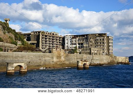 Abandoned island of Gunkanjima off the coast of Nagsaki, Japan. The island was populated as a coal mining town from 1887 but was abruptly abandoned in 1974 due to the rise of petroleum use.