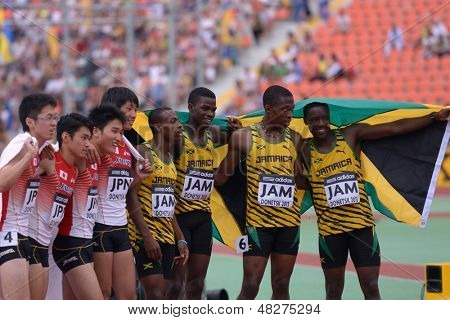 DONETSK, UKRAINE - JULY 14: World Youth Champions in the medley relay team Jamaica and bronze medalist team Japan during 8th IAAF World Youth Championships in Donetsk, Ukraine on July 14, 2013