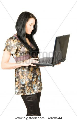 Pretty Casual Woman Works With Laptop. Isolated On White Background