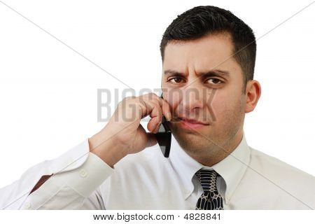Confused Businessman On Cellphone