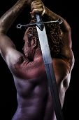 Warrior with big sword, muscular back poster