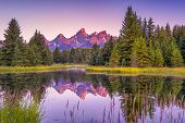 The Teton range's reflection upon the Snake River. Photographed at dawn at Schwabacher's Landing in Grand Teton National Park WY poster