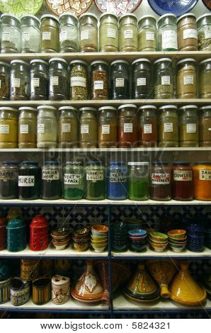 Jars Of Herbs And Powders In A Moroccan Spice Shop.