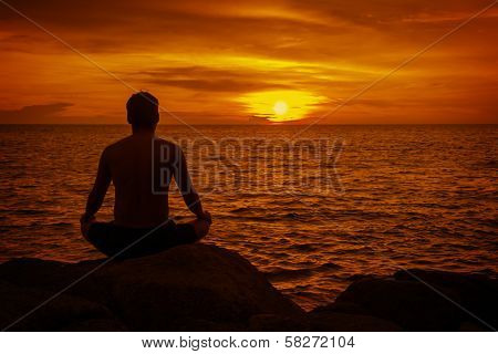 Man Meditating At Sunset. Tropical Beach Of Thailand