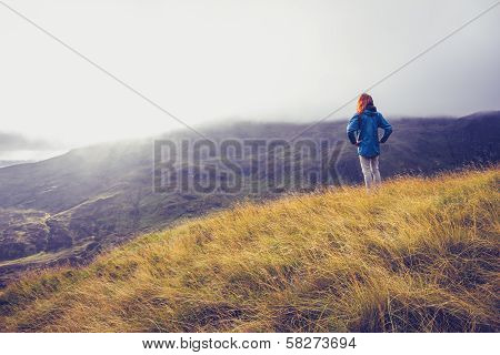 Woman Standing On A Mountain Top