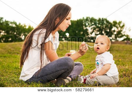 Baby eating outdoors
