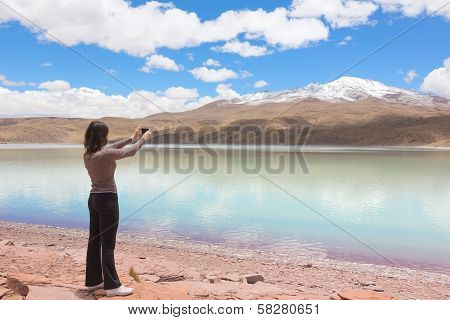 Woman taking pictures on mobile phone
