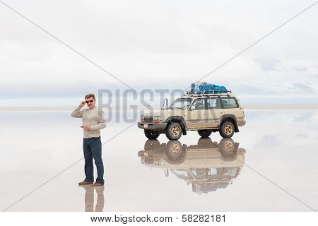 Man and off-road car