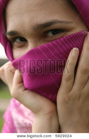 Muslim Woman Smiling And Hiding Her Face