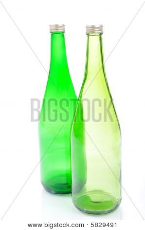 the Two tall  empty green bottles isolated poster