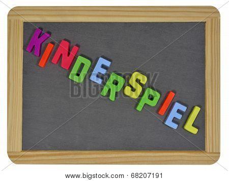 Kinderspiel written on traditional school slate