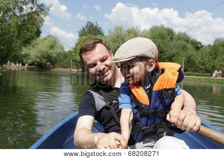 Portrait of father with son in a rowboat poster
