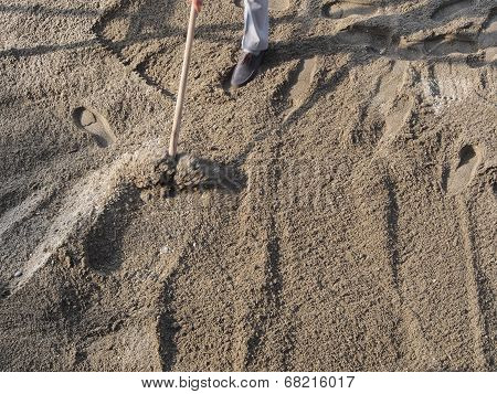 Cleaning And Flattening The Beach With Rake