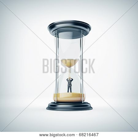 Hourglass with businessman inside
