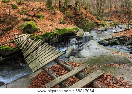 Forest River With Old Bridge