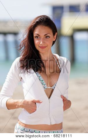 Woman posing in a bikini and sweater
