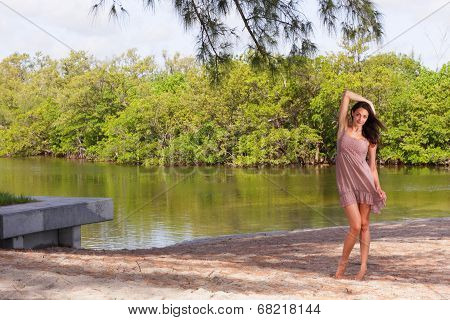 Woman posing address by the lake