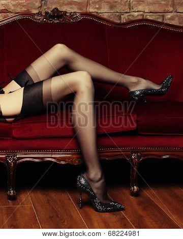 Beautiful long legs  in erotic black stockings