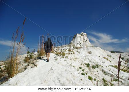 Tourist Climbing Limestone Rock In Pammukale