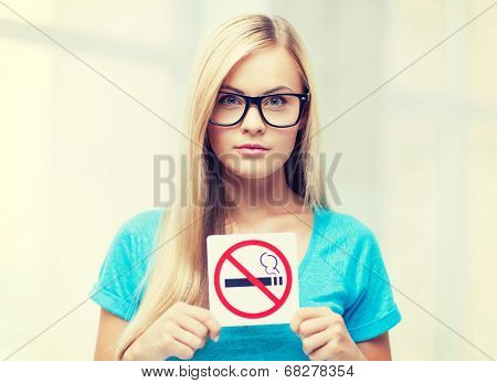 picture of woman with smoking restriction sign