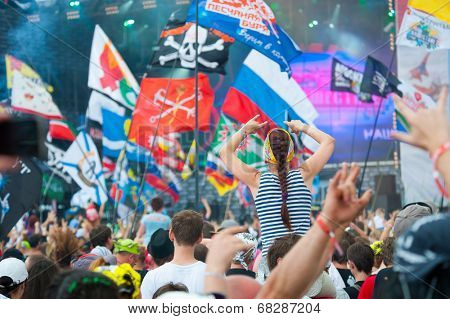 BIG ZAVIDOVO, RUSSIA - JULY 5: People cheering at open-air rock festival