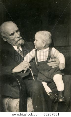 GERMANY, CIRCA TWENTIES - Vintage photo of grandfather with grandson