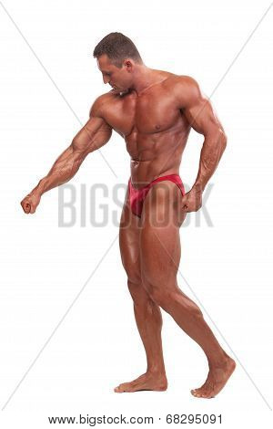 Attractive male body builder demonstrating contest pose isolated on white background poster