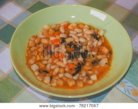 Ribollita meaning reboiled is a Tuscan soup made with bread and vegetables including leftover bread cannellini beans carrot cabbage beans silverbeet kale and onion poster