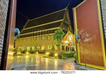 Wooden Door And Golden Buddhist Temple At Night