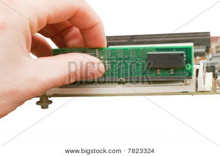 Human Hand Holding A Computer Ram Memory Card On White