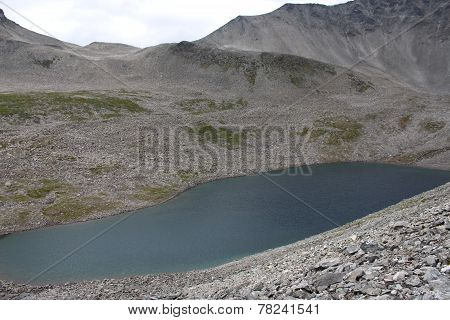 Cold mountain lake. The purpose of our tracking near the Trollstigen, Norway.