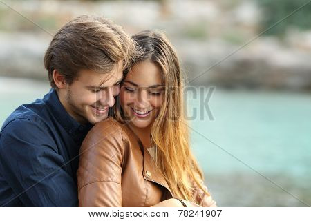 Couple Cuddling Affectionate On The Beach
