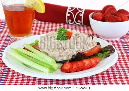 Fresh tuna salad on a plate with tomatoes lettuce celery and healthy strawberries. poster