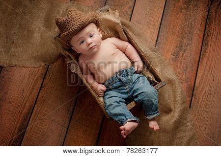 Baby Boy Wearing A Cowboy Hat