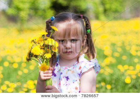 Little Girl On Dandelion Field