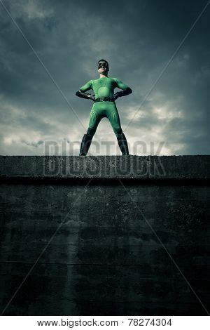 Confident Superhero Standing On A Wall