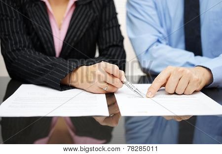 Businessman And Businesswoman Are Pointing To .article Of The Treaty