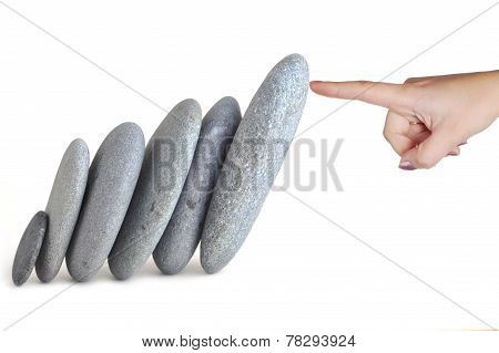 Womans Finger Hold Stones