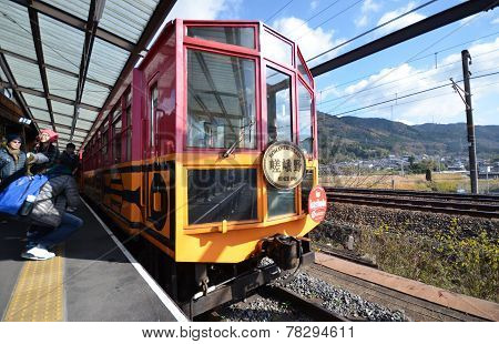 Tourist Take Photo Of The Train At Kameoka Torokko Station