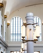 Old Fashioned Ceiling Light Fixture in Public Building poster
