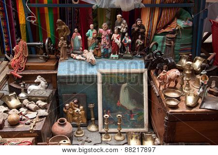 Colorful antique stall with in the popular Otavalo market, Ecuador