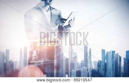 Double Exposure With Businessman Using Digital Tablet. With Special Lighting Effects
